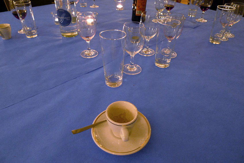 Cup and glasses on blue
