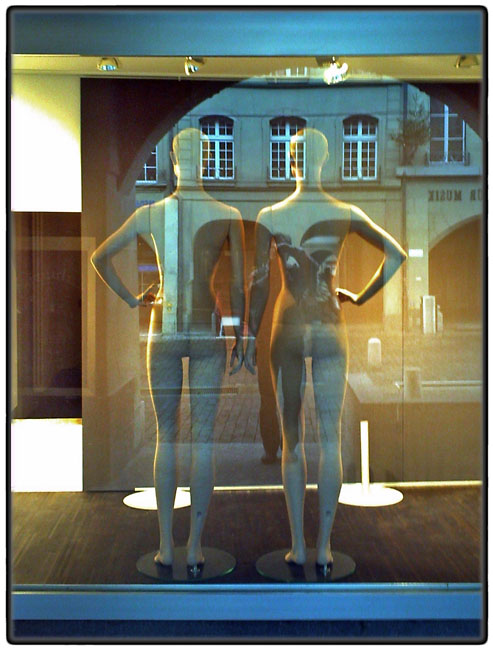 Two mannequins with reflections