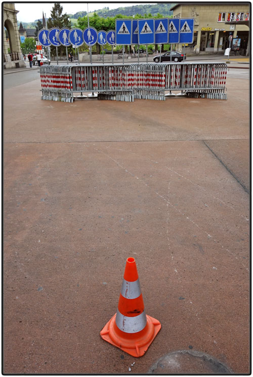 Traffic cone and road signs