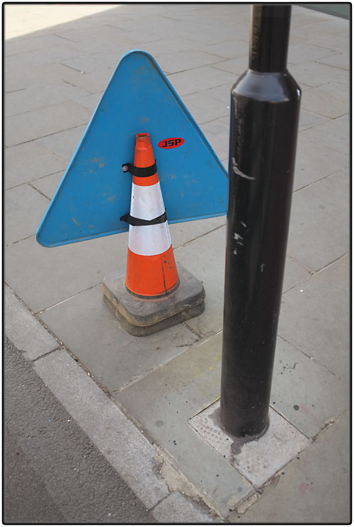Cone with sign attached