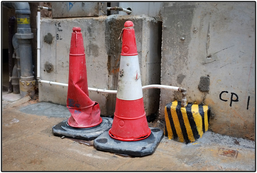 Two cones and black and yellow stripes