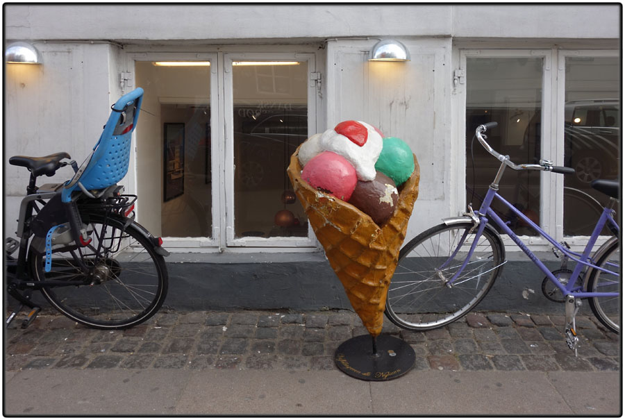 Two bikes and ice cream cone