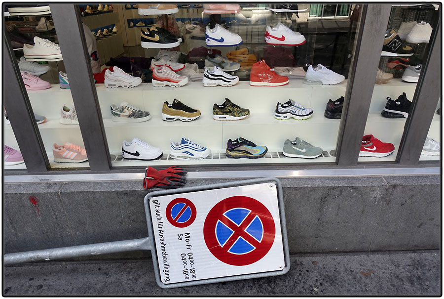 Trainers, gloves and traffic sign
