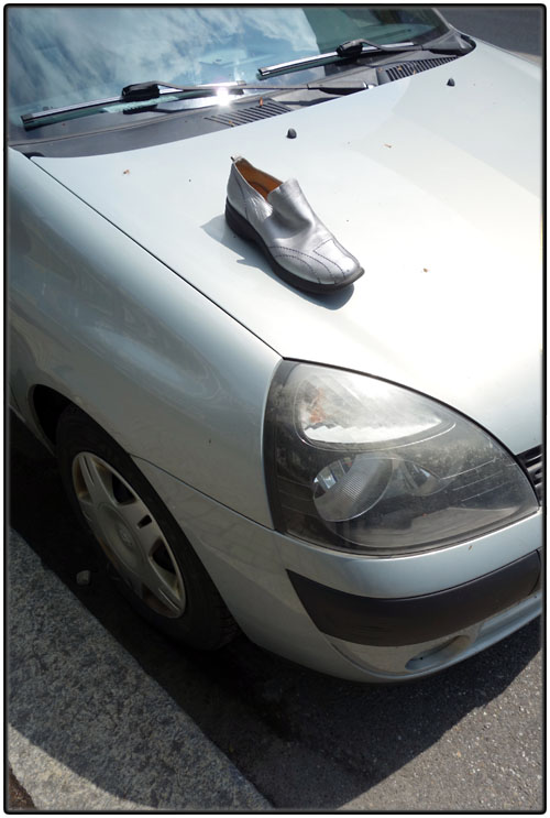 Lost silver shoe on silver car