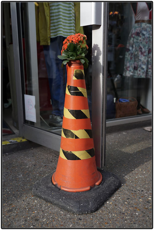 Cone with striped tape and flowers