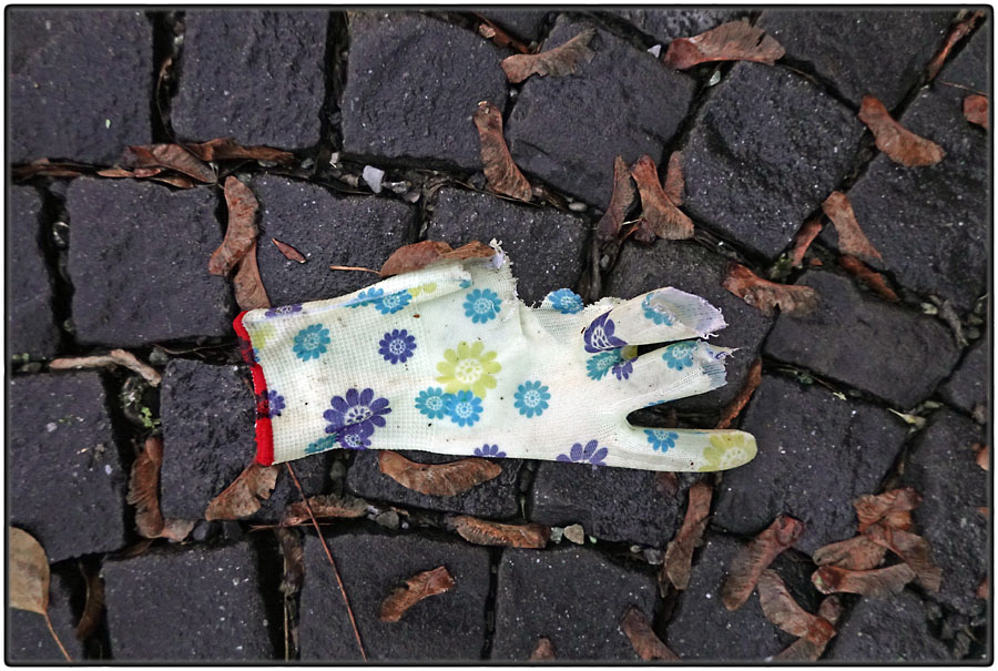 Torn glove with flower pattern